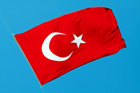 Waving flag of Turkey under sunny blue sky Stock Photo - 14837231