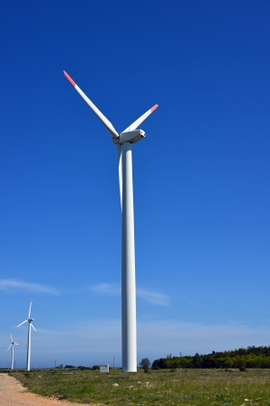 Wind turbines farm - alternative energy source photo