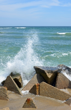 Breakwaters on the sea coast photo