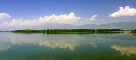 Beautiful landscape with the island being reflected in water photo