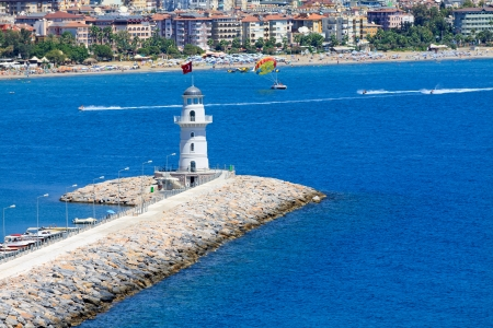 Lighthouse in port of the city of Alania, Turkey photo