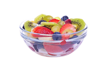 Fruit salad with strawberries, oranges, kiwi and blueberries isolated on white background photo
