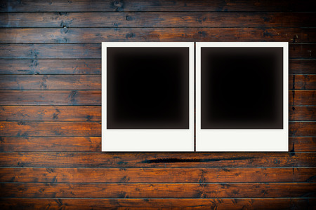 Photo frames on wooden board background texture photo