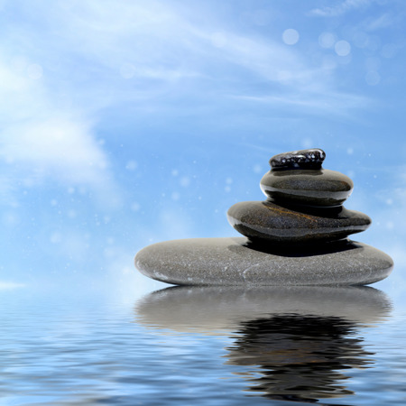 stones in water: Zen massage stones reflected in water Stock Photo