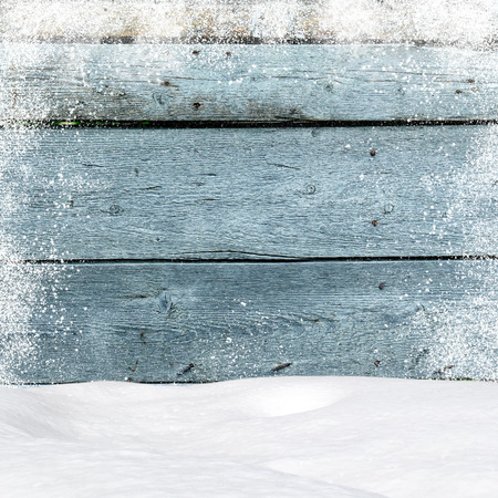 wooden boards: Snowdrifts. In the background old wooden wall with blank space Stock Photo