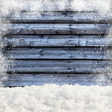 snowdrifts: Snowdrifts. In the background old wooden wall with blank space Stock Photo