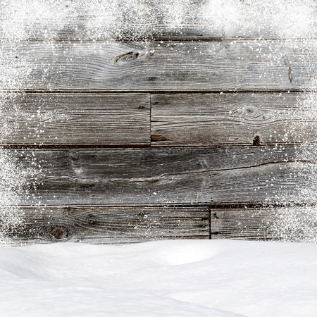 christmas backdrop: Snowdrifts. In the background old wooden wall with blank space Stock Photo