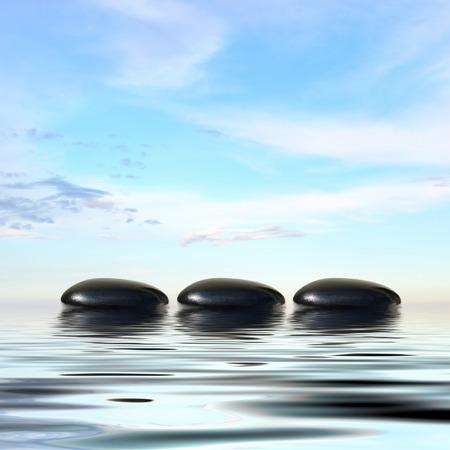 black stones: Zen spa concept background-Zen black massage stones reflected in water Stock Photo