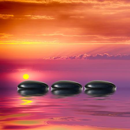 Zen spa concept background-Zen black massage stones reflected in water Stock Photo