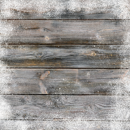 Christmas background with old wooden planks and snow flakes Banque d'images