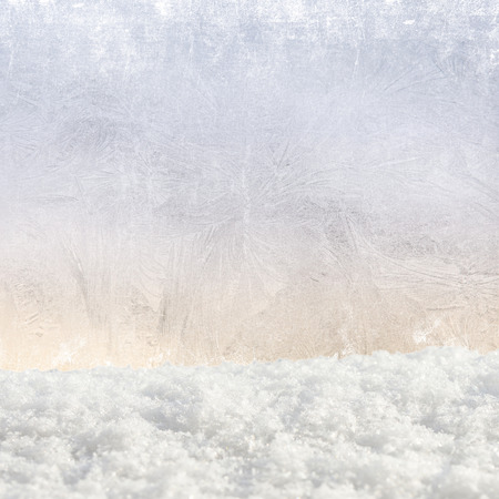 snowdrifts: Christmas festive background with frosted glass and snowdrifts