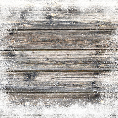 Christmas background with old snow covered wooden planks and snow flakes and snowdrifts