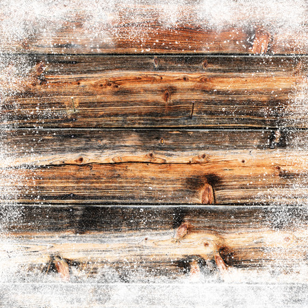 inducement: Christmas background with old snow covered wooden planks and snow flakes and snowdrifts