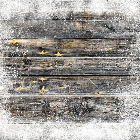 snowdrifts: Christmas background with old snow covered wooden planks and snow flakes and snowdrifts