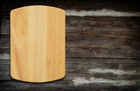 tabletop: Empty cutting board on a wooden table.Top view Stock Photo