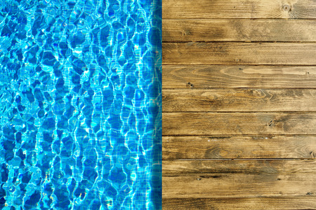 liquid summer: Swimming pool and wooden deck for backgrounds Stock Photo