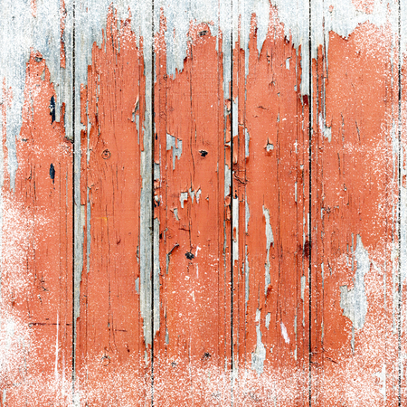 inducement: Old wooden background with snow flakes.Christmas background