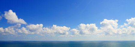 reflected: Panoramic view of clouds reflected in the sea Stock Photo