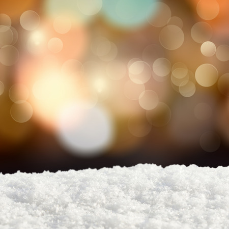 crystalline gold: Winter background.Abstract bokeh lights and snowdrift Stock Photo