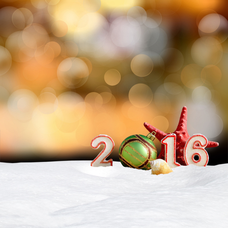 crystalline gold: Christmas background - New year 2016 sign with snowdrift and abstract bokeh lights