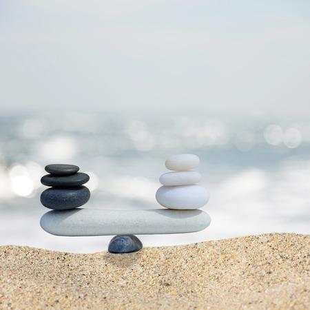 Zen stones balance concept.The balance between black and white