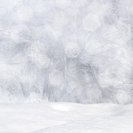 Winter background - Frost patterns on window, snowdrift and bokeh lights