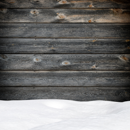 Snow drift on wood boards with blank space
