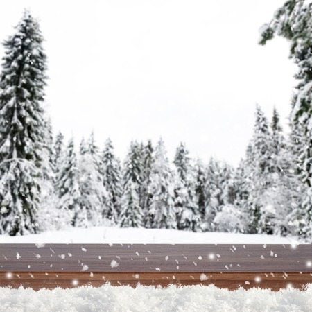 winter wood: Blurred winter background with snow covered forest and shabby table