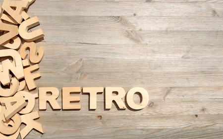 jumbled: Word retro made with block wooden letters next to a pile of other letters over the old wooden planks surface composition Stock Photo