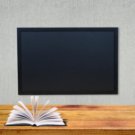 classbook: School class with school board and school desk with open classbook