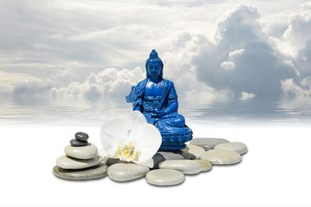 Zen or Feng-Shui background-Blue Medicine Buddha Bhaisajyaguru,zen stone,white orchid flowers and sky reflected in water Stock Photo