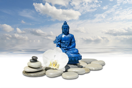 fengshui: Zen or Feng-Shui background-Blue Medicine Buddha Bhaisajyaguru,zen stone,white orchid flowers and sky reflected in water Stock Photo
