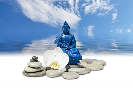 equilibrium: Zen or Feng-Shui background-Blue Medicine Buddha Bhaisajyaguru,zen stone,white orchid flowers and sky reflected in water Stock Photo