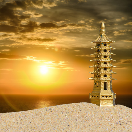 Seven-storied pagoda in the sand at sunrise Stock Photo