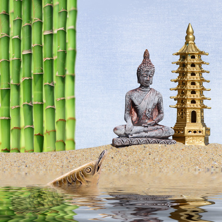 Buddha, bamboo, arowana with coin reflected in the water.Symbol of wealth and great fortune in Feng-Shui