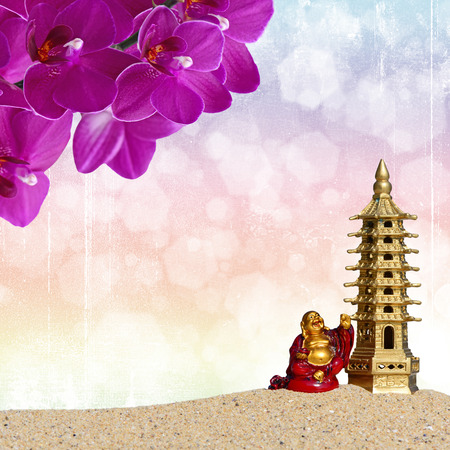 Buddha,orchid flowers and seven-storied pagoda in the sand. Symbol of good luck and prosperity in Feng-Shui