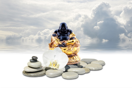 Feng-Shui background-Laughing Buddha or Budai,zen stone,white orchid flowers and sky reflected in water Stock Photo