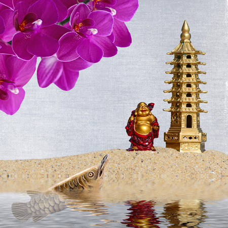 Laughing Buddha,orchid flowers,arowana with coin reflected in the water.Symbol of wealth and great fortune in Feng-Shui