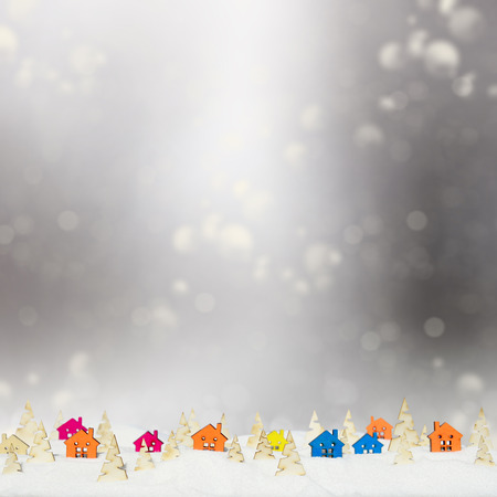 grizzle: Christmas silver background with small wooden houses, Christmas trees and snow Stock Photo