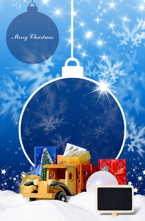 snowdrifts: Blue Christmas background with toy truck car, gifts, New Year fir and balls in the snow Stock Photo