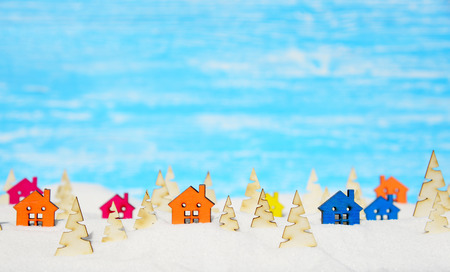 Christmas background.Fairy Village in the winter forest and snow pile Stock Photo