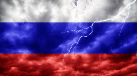 Russian flag against dark sky, clouds and lightning