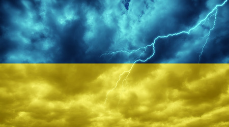 Ukrainian flag against dark sky, clouds and lightning
