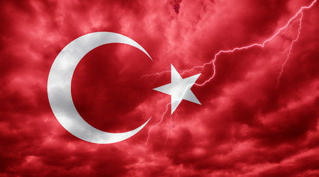 Turkish flag against dark sky, clouds and lightning