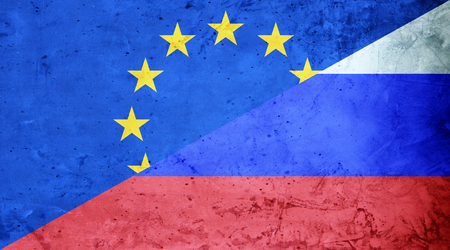 EU flag and Russian flag cement texture