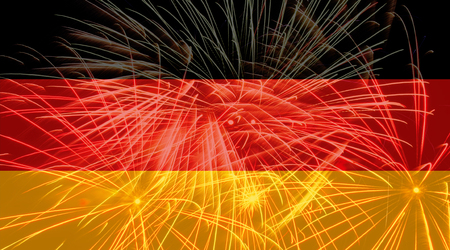 German flag against fireworks
