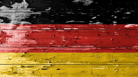 German flag on wood texture background with old paint peels