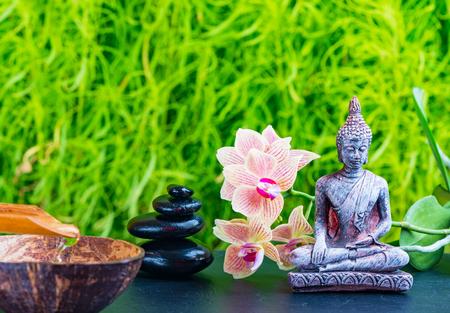 Zen garden background with buddha, orchid flower and zen stones