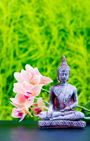 Stock Photo   Zen Garden Background With Buddha And Orchid Flower