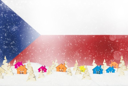Christmas background with Czech Republic flag, small wooden houses, Christmas trees and snow.
